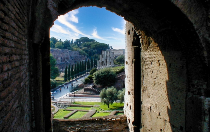 a view from a door of the Colosseum in Rome. Italy looking out at the countryside and blue skies on a single day